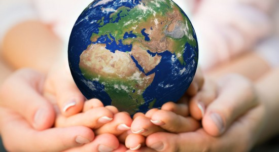 26427410 - family holding earth in hands.